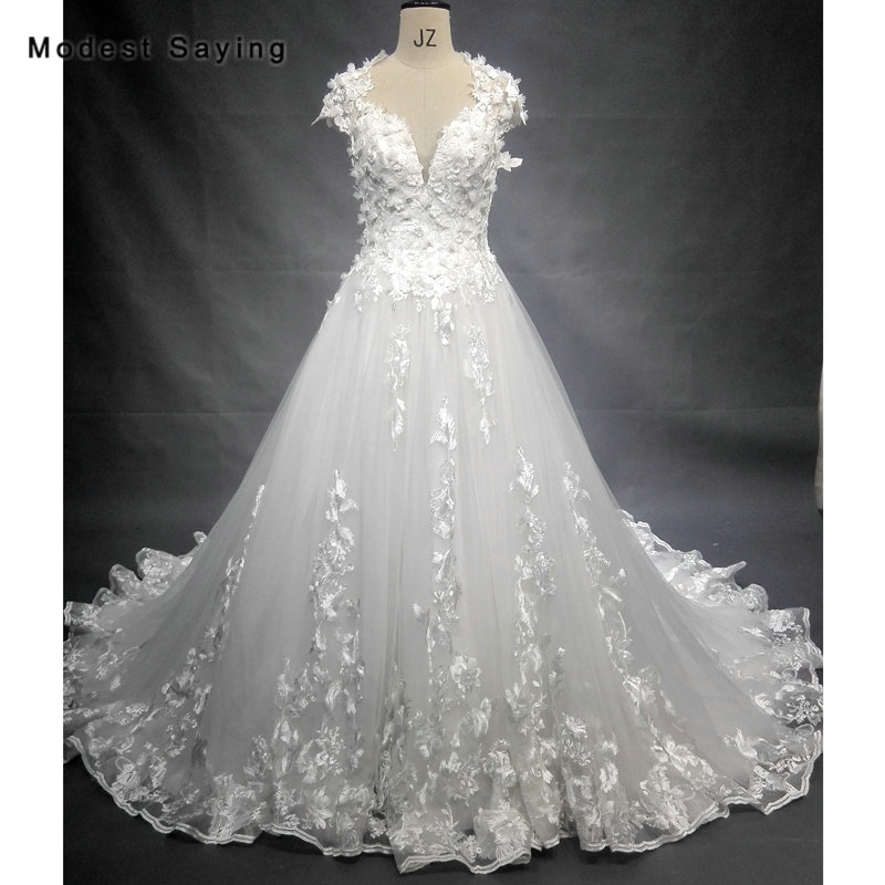 Beaded Illusion Back Wedding Dress: Elegant Ball Gown Cap Sleeves Ivory Flowers Beaded Lace