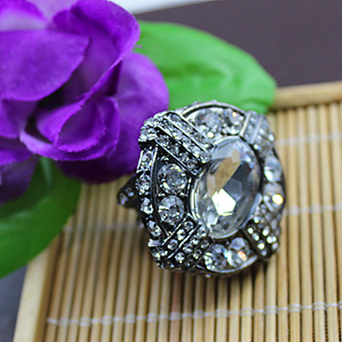 An exaggerated fashion big ring. Filled with semi-precious stones. Hollow out design. Classic fashion ladies accessories