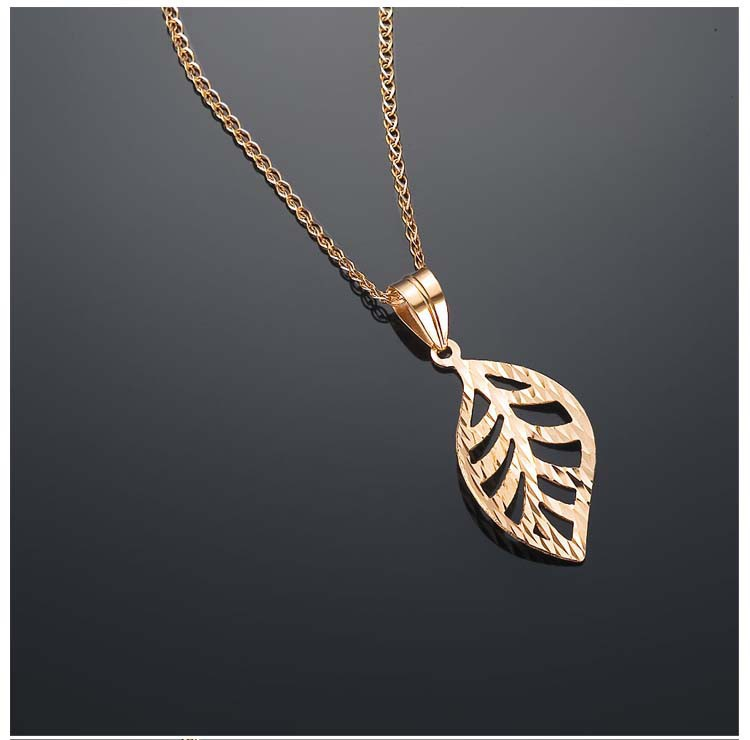 in white theme rose leaf glazed gold pendant