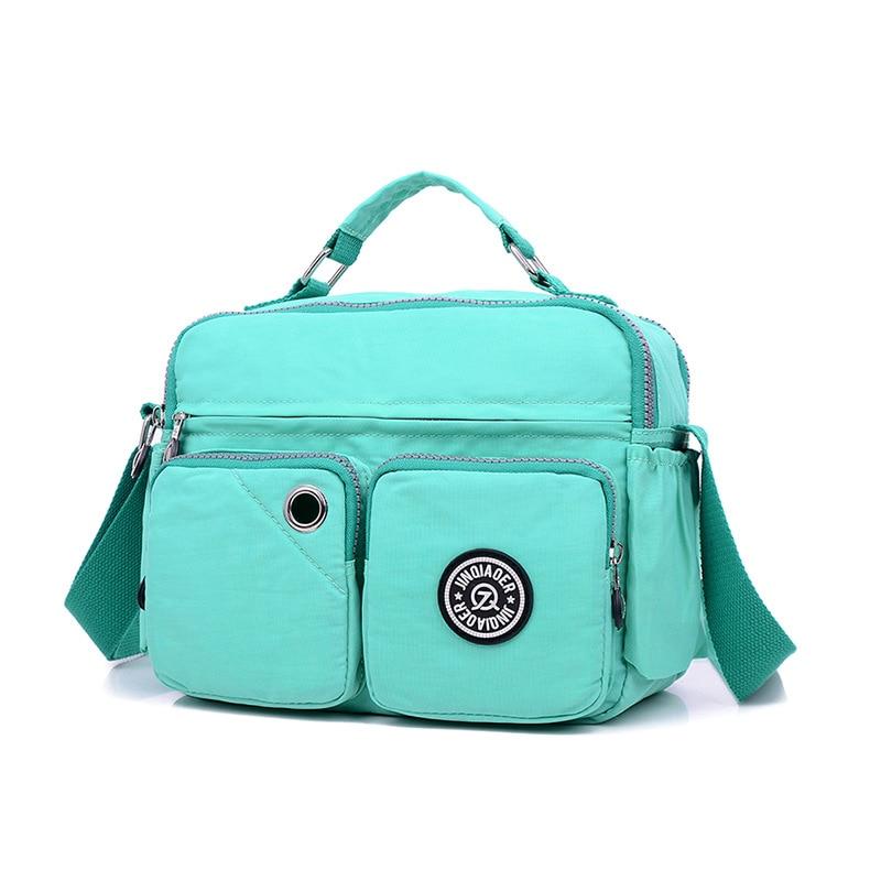 цены на JINQIAOER Women Shoulder Bags Waterproof Nylon Lady Multi-function Messenger Bag Feminine Small Crossbody Bags For Women Handbag в интернет-магазинах