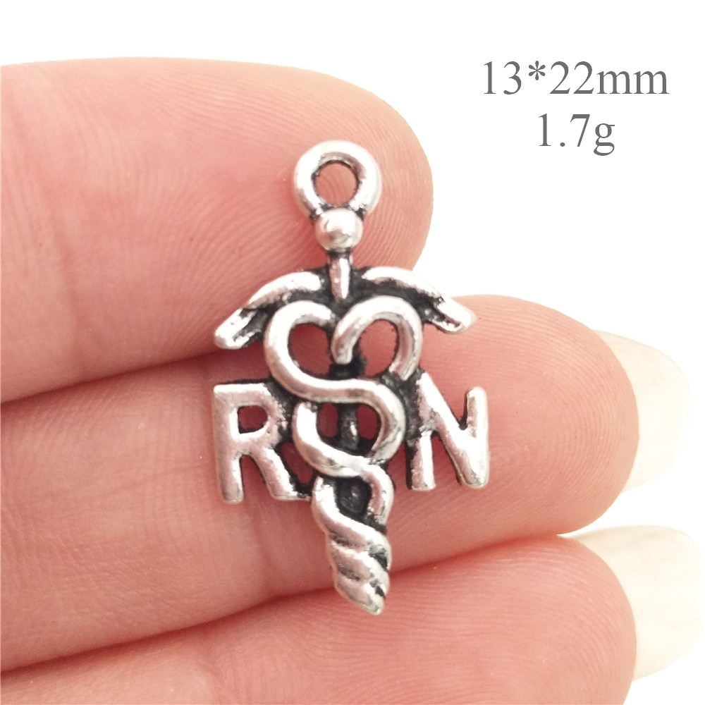 Bulk 30pcs lots zinc alloy metal rn for registered nurse charms bulk 30pcs lots zinc alloy metal rn for registered nurse charms antique silver tone medical symbol pendant 1322mm 17g in charms from jewelry accessories biocorpaavc Gallery