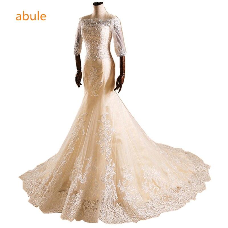 abule Romantiska Bröllopsklänningar Mermaid Sexig båthalsbandet Champagne Skräddarsydda Bröllopsklänningar Brudapplikationer Vestido De Noiva
