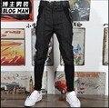 Корейских мужчин случайные брюки загрузки вырезать ноги брюки парикмахер полосатый поддельные две шаровары Ударил цвет Сращивания полная длина костюмы