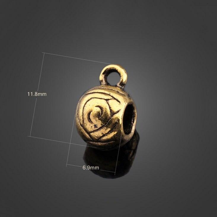6aa54cbc3a6a 200 unids Antique oro ronda joyería del grano Amuletos Colgantes metal de  la pulsera del collar de la manera Accesorios 11.8mm x 6.9mm