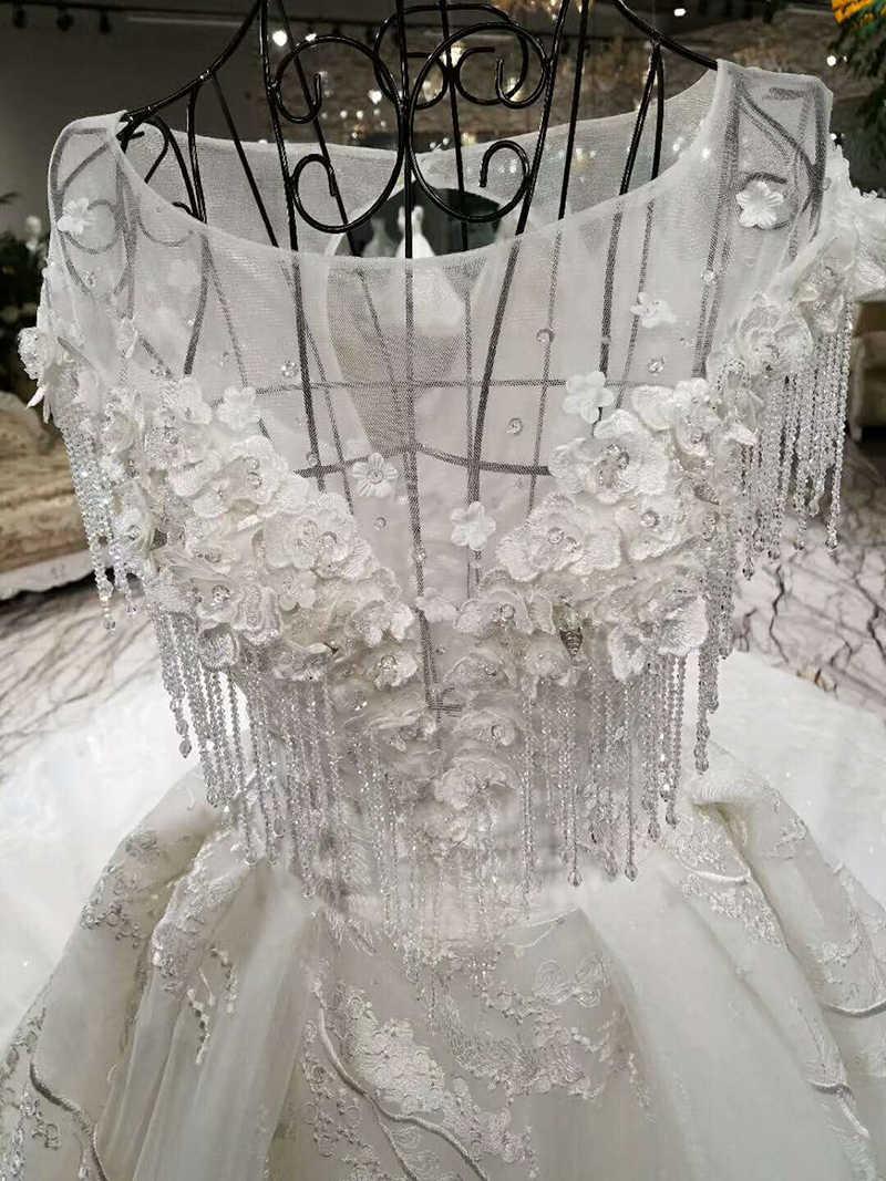 LSS004 יוקרה חתונת שמלה ואגלי כדור שמלת תחרה למעלה קצר שרוול 3D פרחי כלה שמלות קתדרלת רכבת נדל תמונות