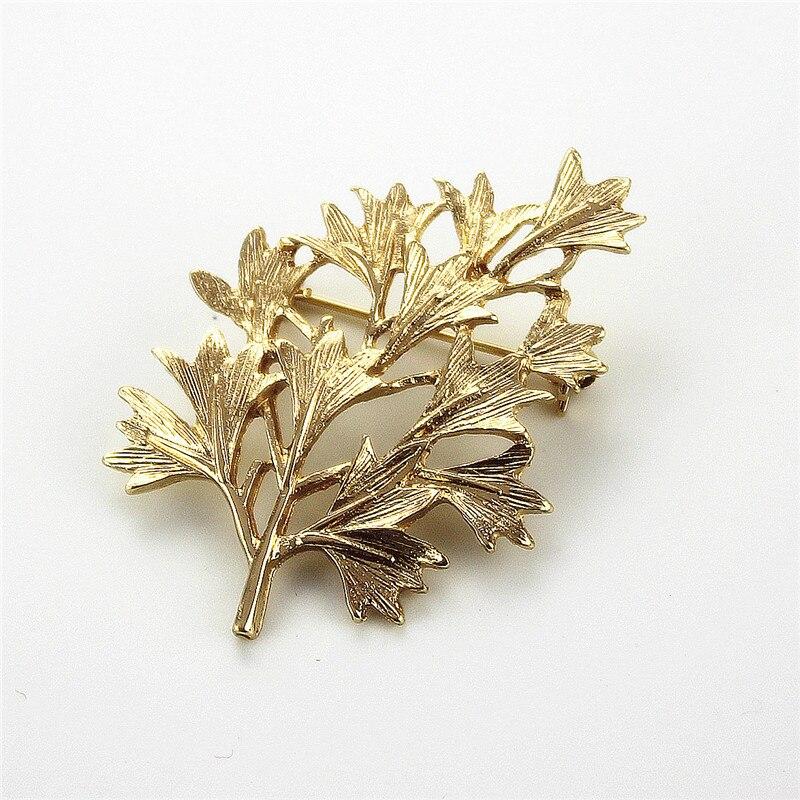 dbec8de11fde Envío gratis nuevas mujeres joyería tecnología de aleación broche moda  Golden Leaf accesorios de alta calidad regalo