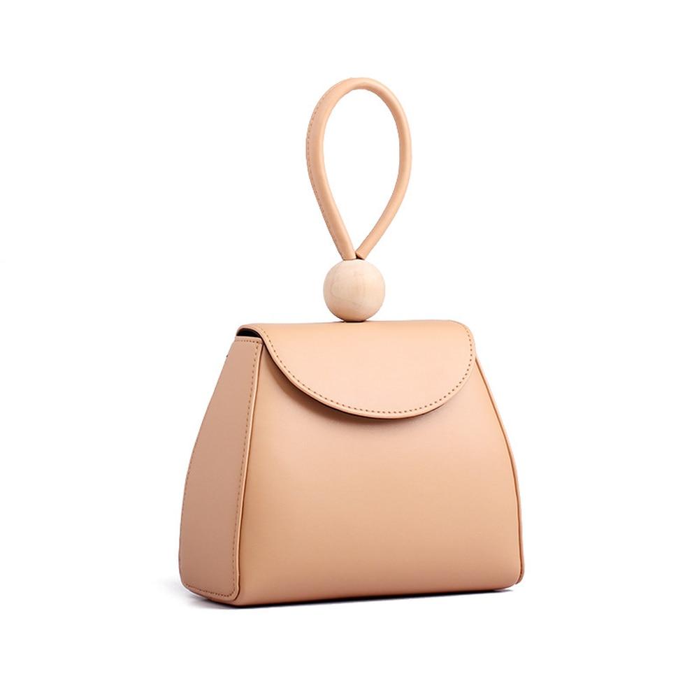 Spring Summer 2019 New Korean Version Minimalist Japanese Style Handbag Log Wood Bead Soft Solid Fashion