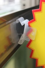 Plastic promotional sign holder price tag display shelves rack pop clips store supermarket aisle entry advertising