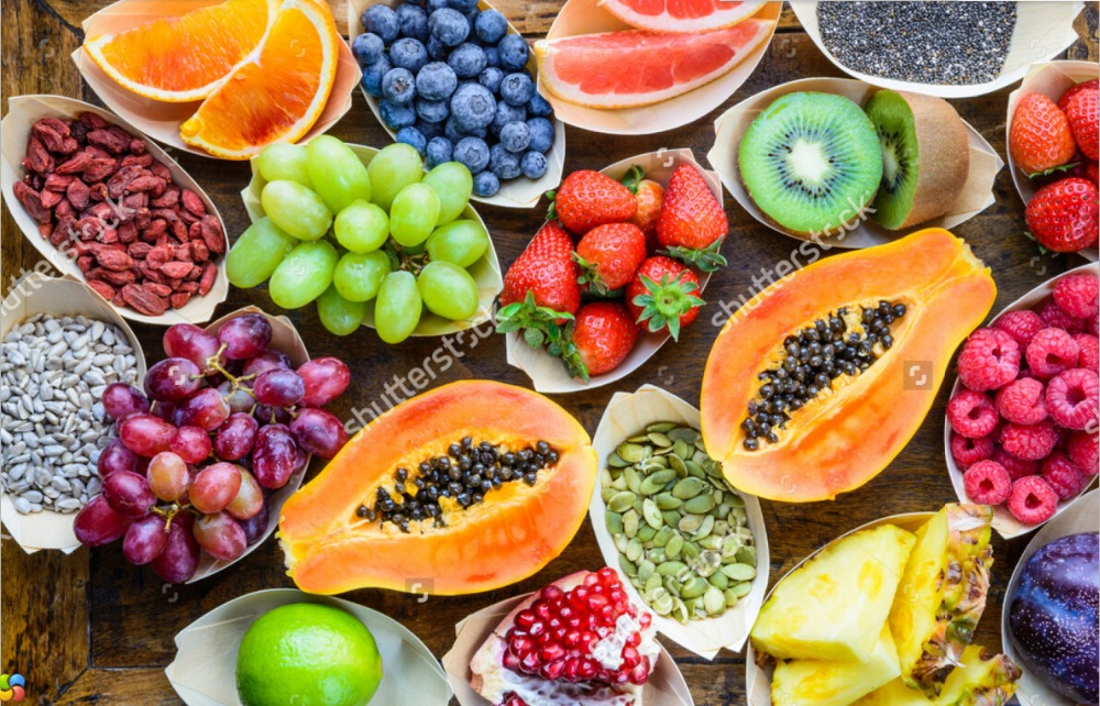 Fruit wallpaperFruits berries nuts seeds top view on wood3D