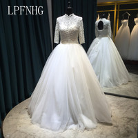 2018 Ball Gown Wedding Dresses High Neck 3 4 Sleeve Backless Low Lace Up Floor Length