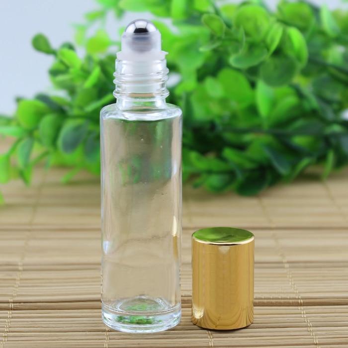 15 ml botella de vidrio con (bola de acero) en rollo brillante tapa de oro crema