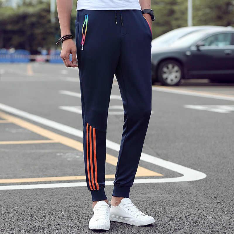 男性のカジュアルパンツ 2019 春ズボン男性パンツスリムフィットスウェットパンツ綿ジョガーストライプボディービルジムパンツスポーツウェア