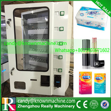 small commodity vending machine with glass window with coin acceptor and bill acceptor