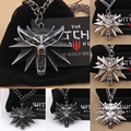 the Wizard wolf head pendant necklace for the Witcher 3 Geralt with a monchichi sleutelhanger The Wild Hunt 3 Figure Game
