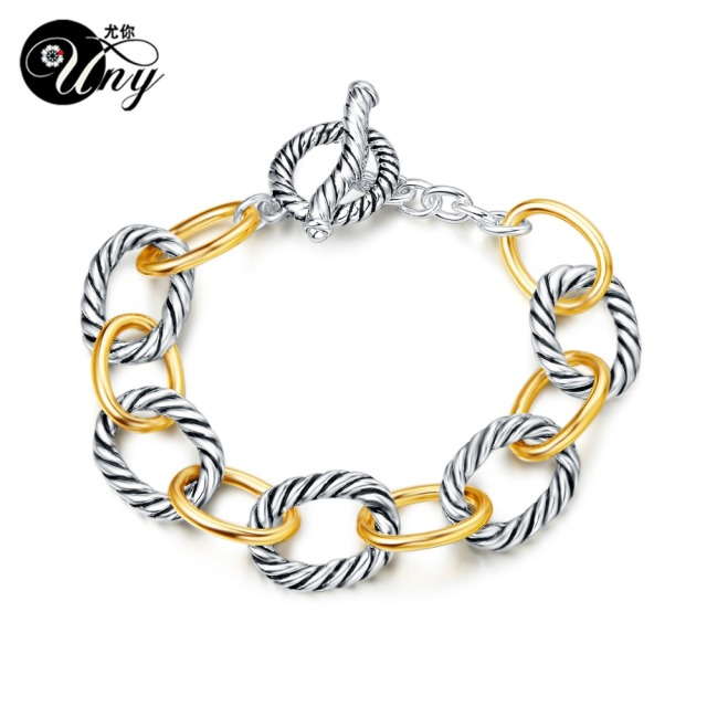 gold and silver bracket bracelet