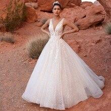 Luksusowy pociąg katedralny koronkowe aplikacje tiulowa suknia ślubna dla nowożeńców Vestidos De Novia suknia ślubna z głębokim dekoltem w serek