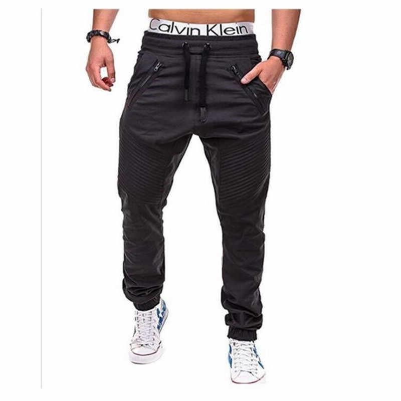 Spodnie marki mężczyźni 2019 moda wielu-kieszeń jednolity kolor biegaczy elastyczne talia Khaki Cargo spodnie na co dzień kombinezony Hip Hop