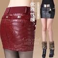 Sexy bordado mujeres de cuero falda delgada de la cadera falda otoño y el invierno de la PU falda corta femenino 2015 ropa de cuero