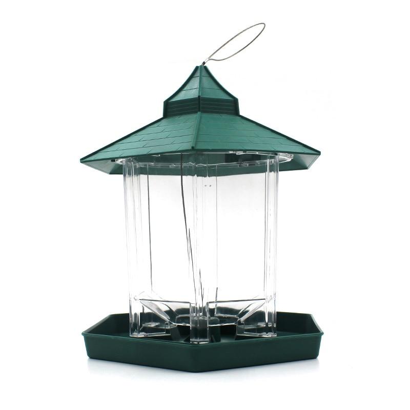 фидер птицы на открытом воздухе
