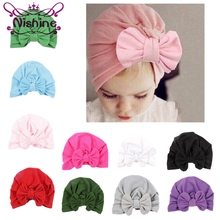 Nishine 10pcs/lot 10 Colors Newborn Kids Big Knot Bowknot Soft Cotton Blend Hat Caps Girls Clothes Accessories Christmas Gift