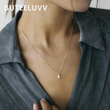BUTEELUVV Minimalist 2 Layered Chain Necklace for Women Bohemian Delicate Baroque Faux Pearl Pendant Necklace Fashion Jewelry layered faux pearl body chain
