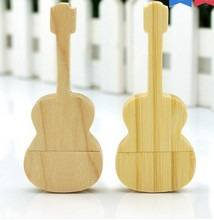 Wooden guitar shaped pen drive