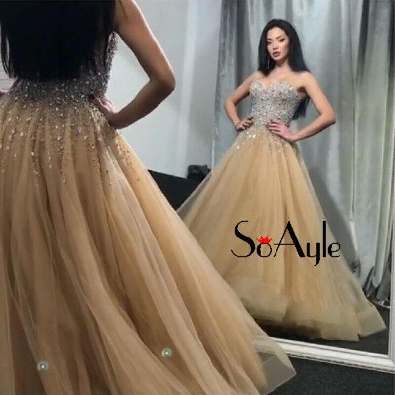 Aliexpress.com   Buy SoAyle A Line 2018 Prom Dresses Champagne Beading  Evening Dresses Luxury Vestidos De Festa Bling Formal Dress Graduate Gowns  from ... 03bf9659d3ce