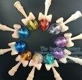 100 PCS New arrivals Frete grátis bola de cristal Jogo kendama toy Kids alça Feita de Faia