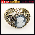 Vintage Statement Hollow Out Flower Crystal Bronze Carved Cameo Statue Queen Beauty Rhinestones Metal Bangle Bracelet for Women