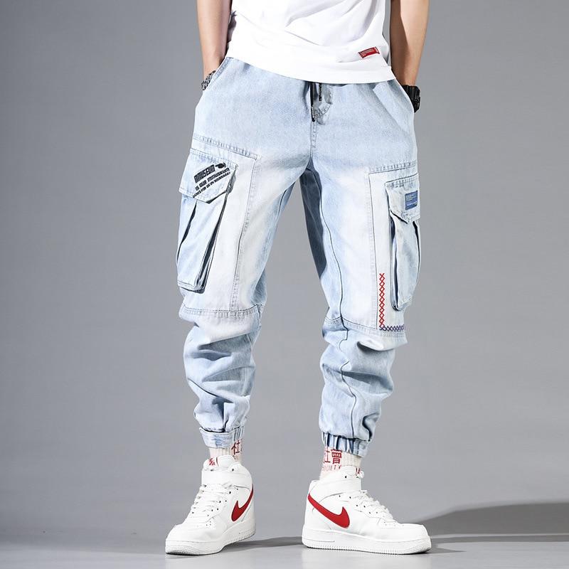 Fashion Streetwear Men Jeans Light Blue Loose Fit Multi Pockets Cargo Pants Harem Jeans Men Embroidery Designer Hip Hop Joggers