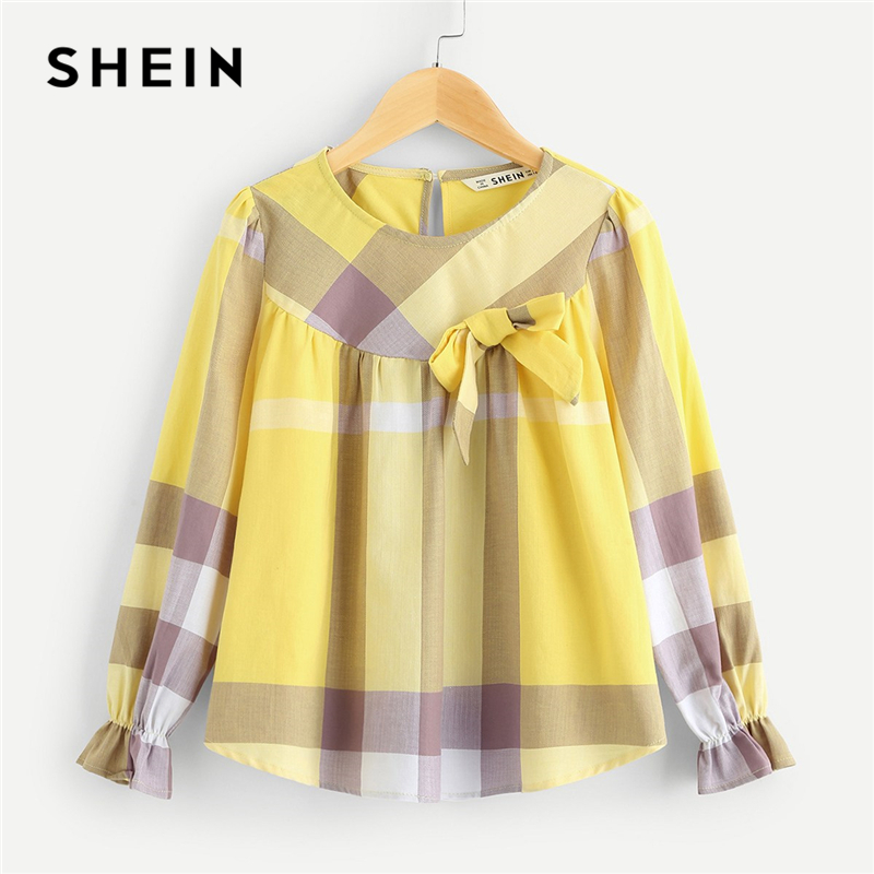 все цены на SHEIN Kiddie Bow Embellished Keyhole Back Plaid Girls Blouse Kids Tops 2019 Spring Flounce Sleeve Button Cute Teenager Shirts