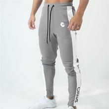 Pantalon de jogging pour hommes, pantalon de survêtement pour gym, Fitness, couture avec fermeture éclair à la cheville, pantalon mince de marque pour hommes