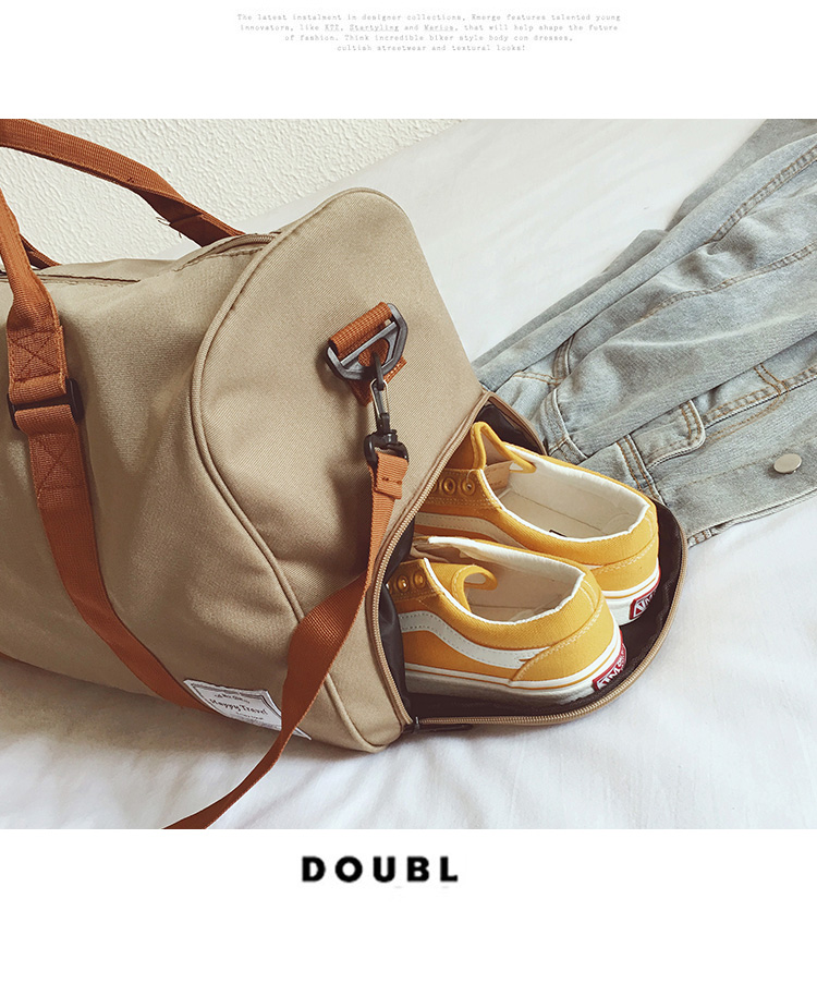 a beige duffle with a pair of yellow trainers inside