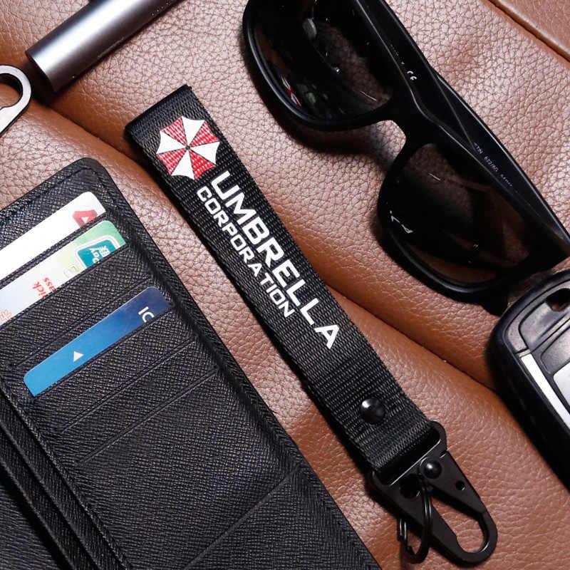 Noizzy Umbrella Corporation Logo Mobil Gantungan Kunci Pribadi Logam AUTO Kunci Wrist Lanyard Gantungan Kunci untuk Pria Aksesoris Baru