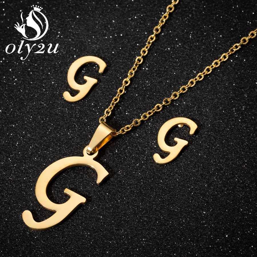 Oly2u dernier pendentif collier boucles d'oreilles ensembles de bijoux pour les femmes en acier inoxydable longue chaîne collier boucles d'oreilles ensemble de bijoux