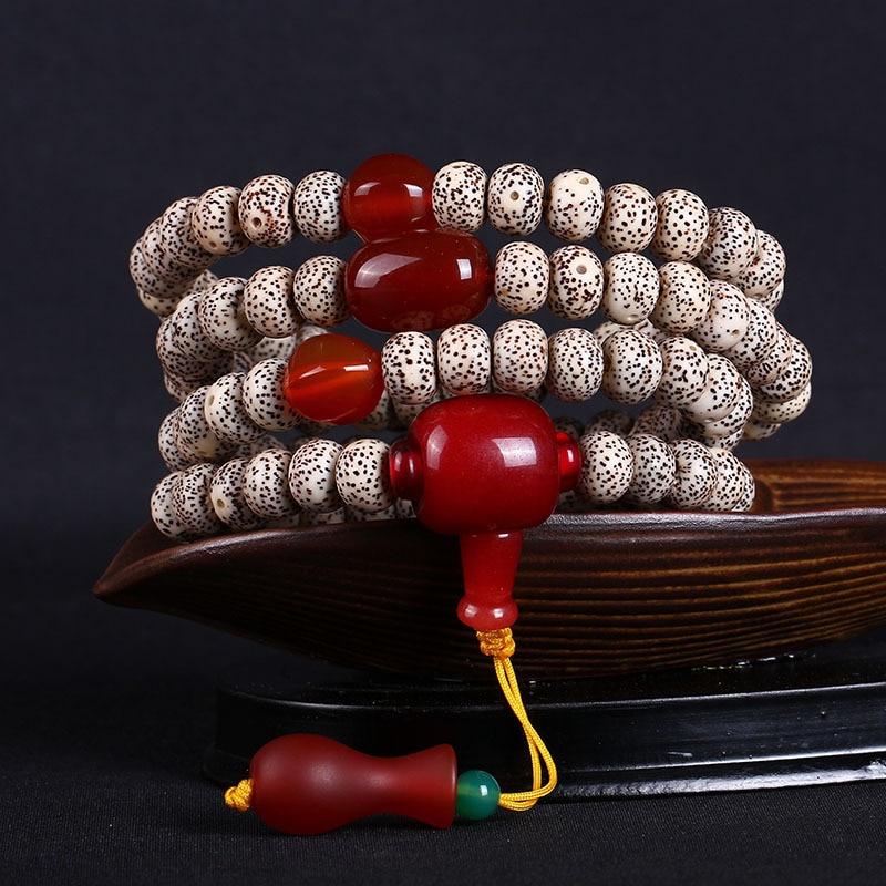 Hainan Bodhi 108 bracelets suspendus bouteilles en verre du paragraphe de densité de broyage à sec Bodhi perle son main sur