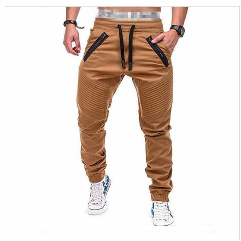 Pantalones De Marca Para Hombre 2019 Pantalones A La Moda De Varios Bolsillos De Color Solido Pantalones De Carga Caqui Con Cintura Elastica Monos Casuales Hip Hop Pantalones Tipo Cargo Aliexpress