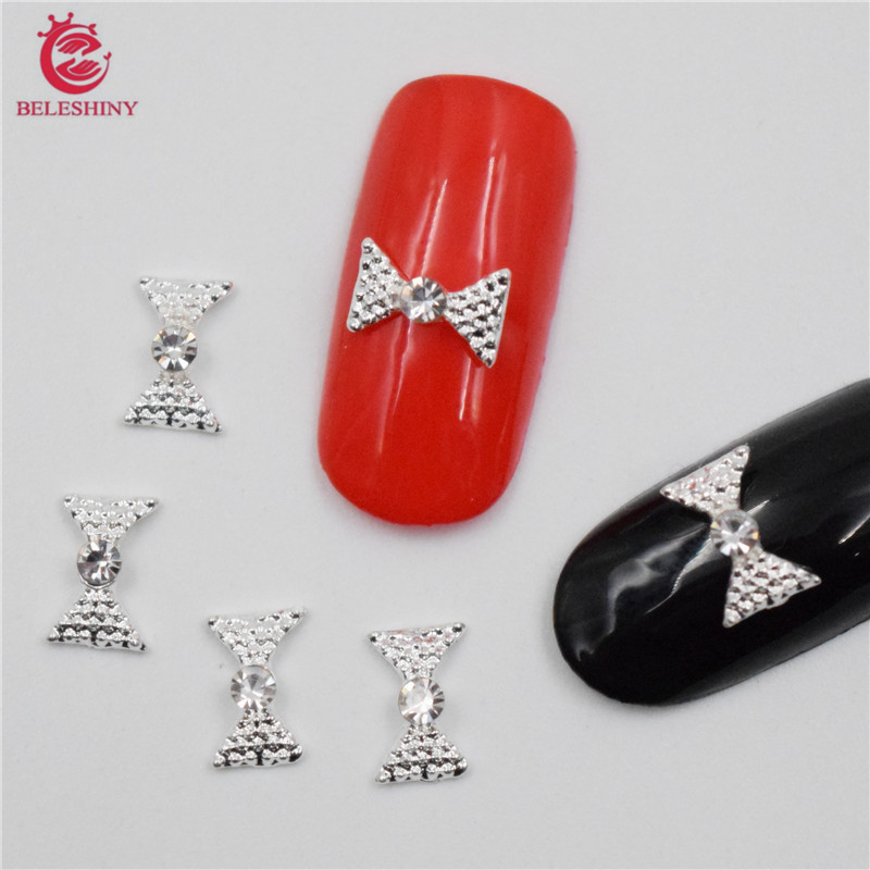 Beleshiny 50pcs New Silver Bow Beauty & Health 3d Metal Alloy Nail Art Decoration/charms/studs,nails 3d Jewelry Nail Supplies H100 Easy To Repair