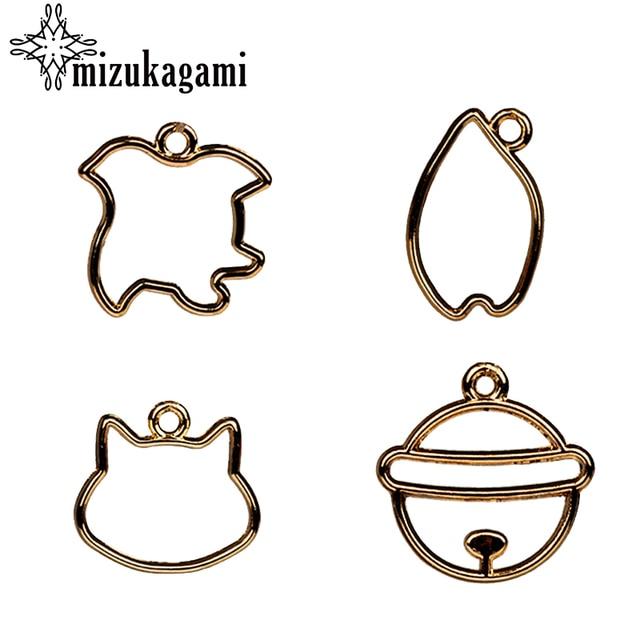 Zinc alloy charms pendant flat gold hollow small cat bell shapes zinc alloy charms pendant flat gold hollow small cat bell shapes uv resin charms pendants aloadofball Gallery