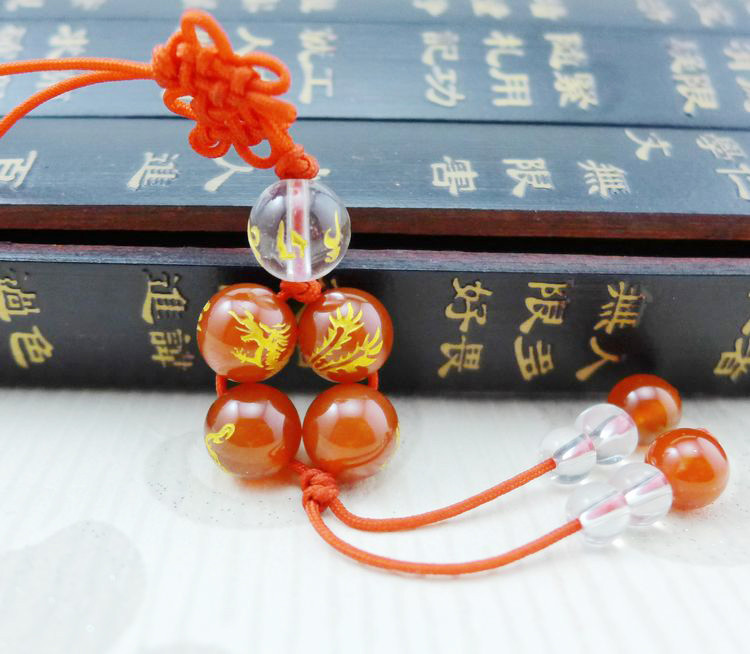 Long Yi red agate bracelet to wear their mobile phone chain polymerization mascot 3000559 long yi painted red lacquer carving pendant with rich fish car hongfu snake zodiac mascot 2000599 years