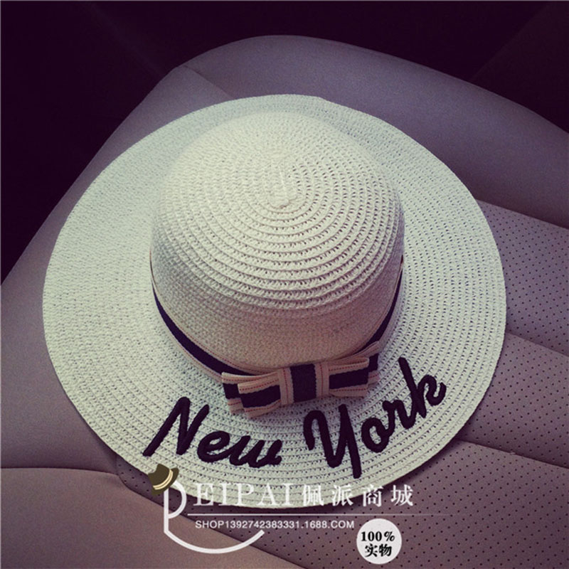 ebece2ccb5c Hot sale new york letter Seaeside sun hats for women summer large brimmed  straw hat folding beach girls sun hat wholesale-in Sun Hats from Apparel ...
