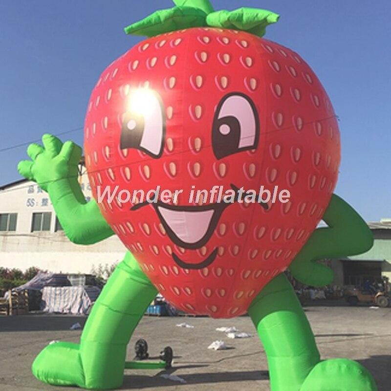 Bande dessinée gonflable géante de modèle de fruit de fraise gonflable de mains de 5mH belle pour la publicité