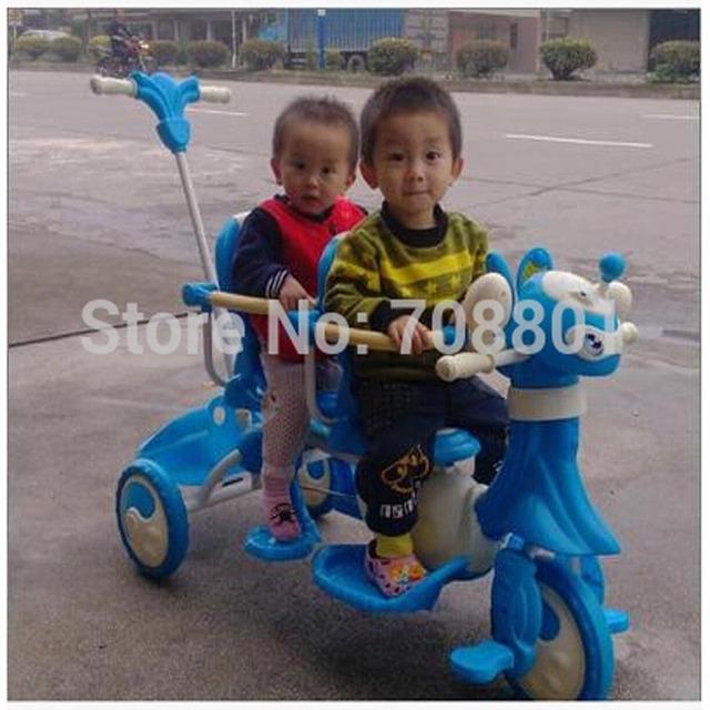Xinghua parte Dos Desenhos Animados gêmeos Trike com estrutura de aço e PP, tandem triciclo dos miúdos, rosa e azul 2 cores disponíveis para