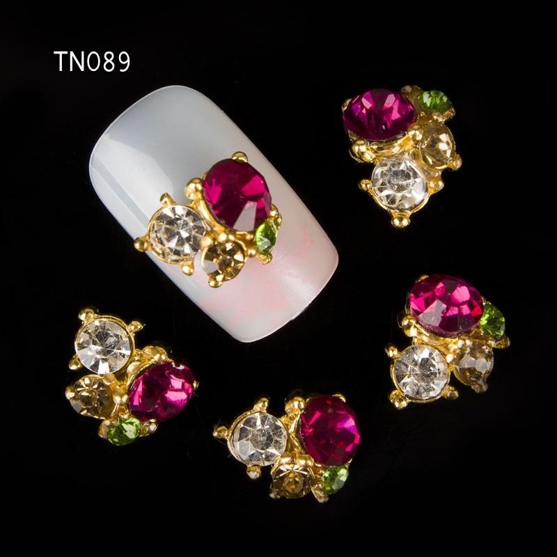 00f44eab92ca Azul 10 piezas 3D de uñas rojo de aleación de diamantes de imitación de  uñas decoración arte encantos pendientes de Metal uñas accesorios de joyería