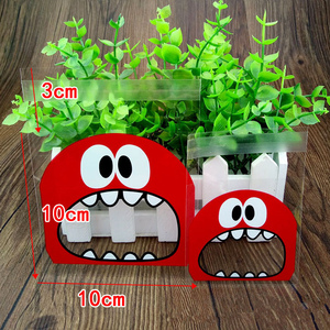 Image 3 - 50Pcs Cute Big Teeth Mouth Monster Plastic Bag Wedding Birthday Cookie Candy Gift Packaging Bags OPP Self Adhesive Party Favors