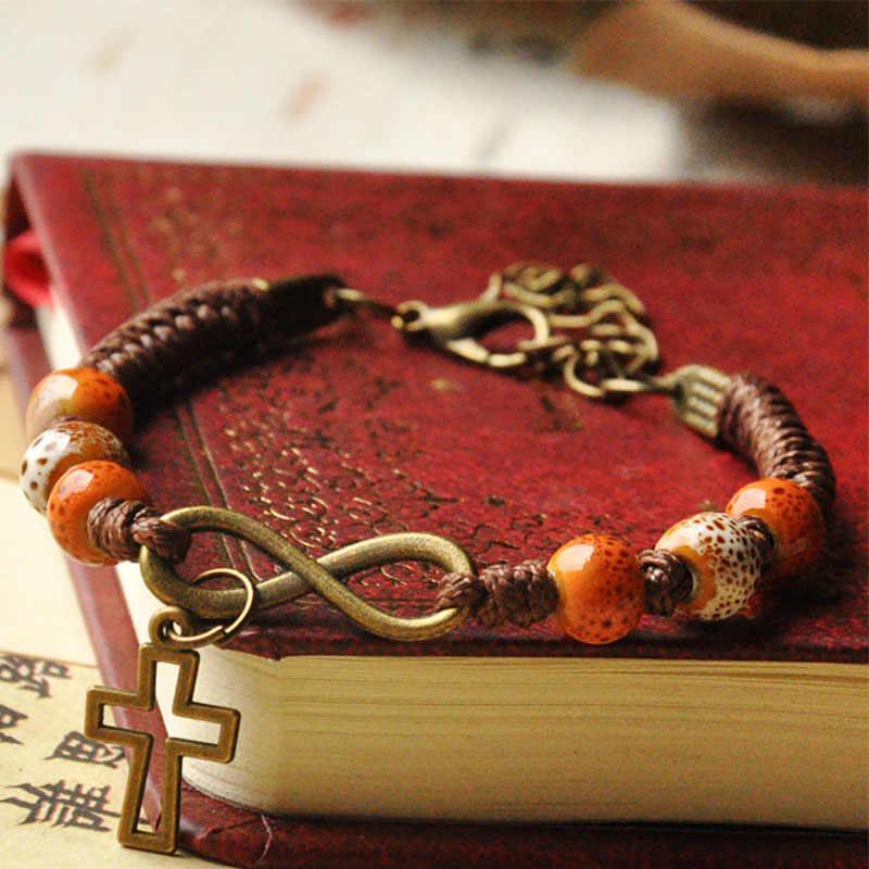 Perline di ceramica Braccialetti di Fascino Trasversale Infinity Pendente della Corda Del Tessuto Catena Del Polsino Regolabile Braccialetti Donna Uomo Gioielli