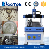 3d wood carving cnc router AKM6090 cnc router vacuum table/T slot table mini cnc 6090 cnc router wood carving machine for sale