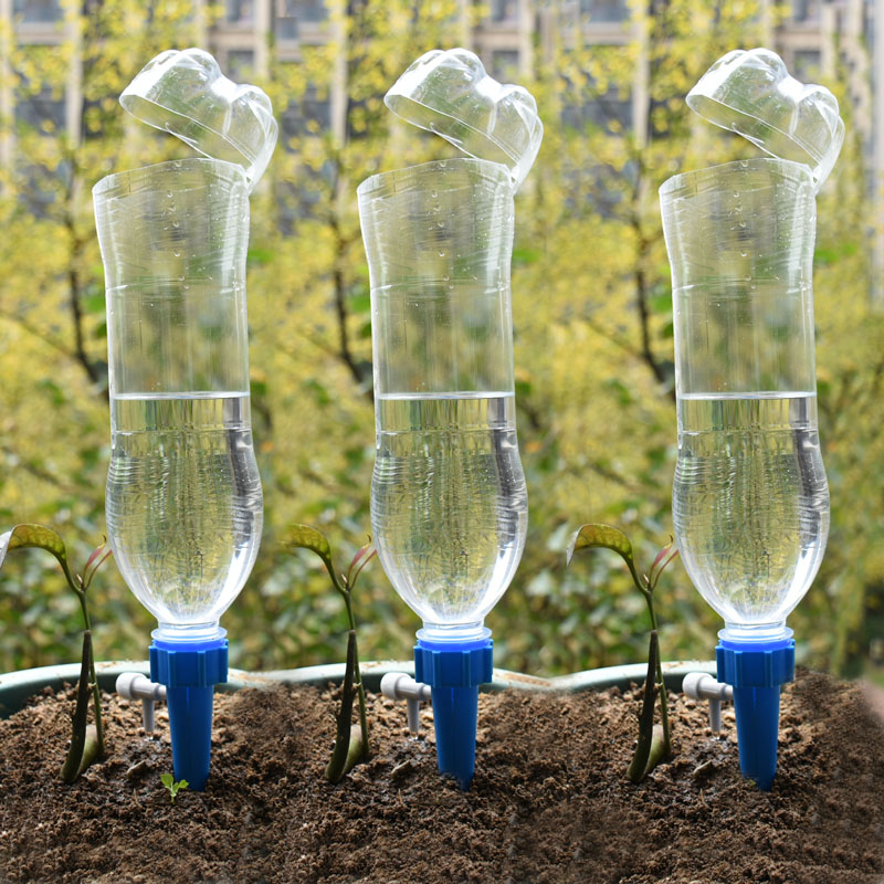 Drip irrigation system Plant Waterers DIY Automatic drip water spikes taper watering plants automatic houseplant watering Drip irrigation system Plant Waterers DIY Automatic drip water spikes taper watering plants automatic houseplant watering 1pcs