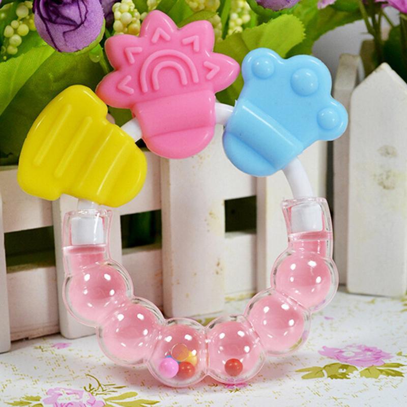 Levendig 1 Stks Kleurrijke Siliconen Handbell Jingle Baby Bijtring Educatief Speelgoed Tanden Bijten Voor Babies Rammelaar Speelgoed Voor Bed Bel Goed Verkopen Over De Hele Wereld