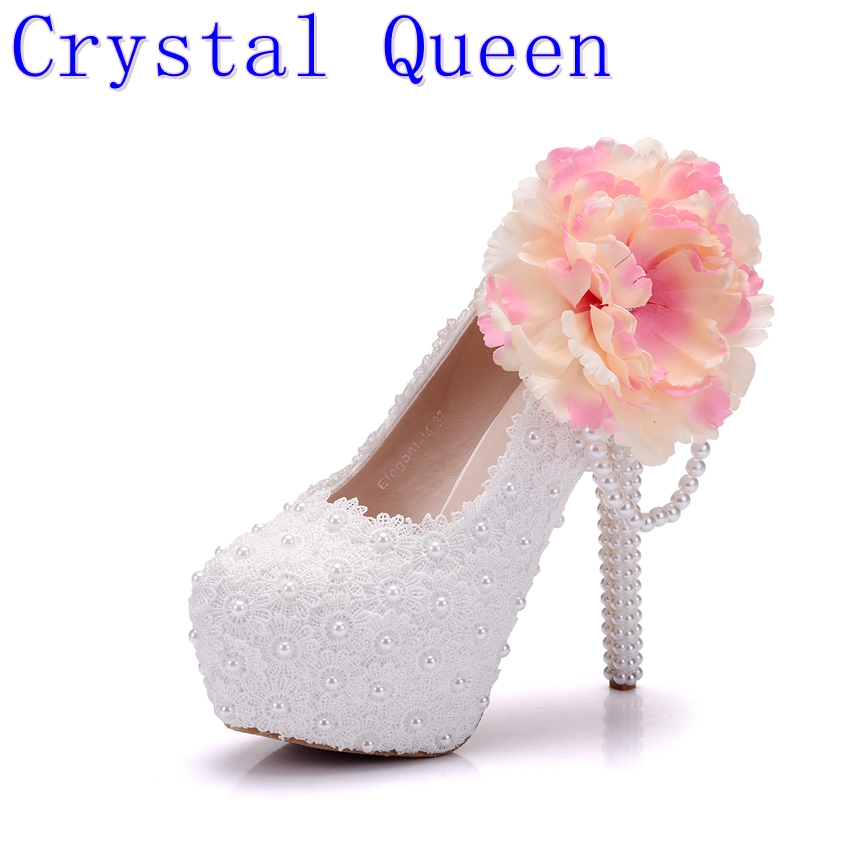цена на Crystal Queen Big Flowers White Lace Women Wedding Shoes High Heel Platform Pumps Sexy Slip ON Bridal Shoes White Part